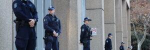 Police guarding building